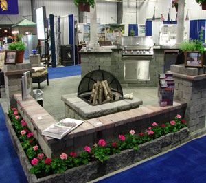Cambridge pavingstones think spring warm up to the for Display home garden designs